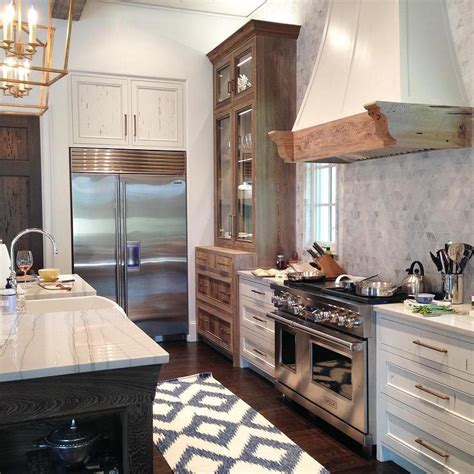 kitchen cabinets that sit on countertop white and navy blue kitchen with white pecky cypress range