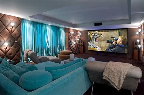 lavish home theater in blue and brown with plush decor