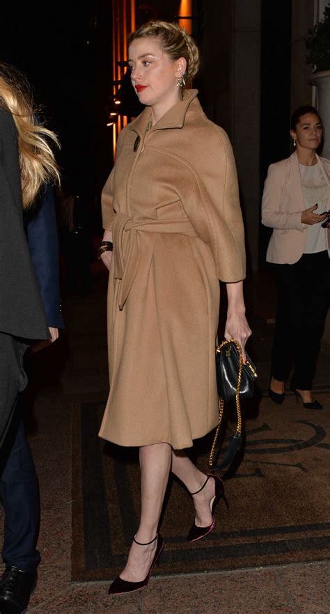 amber heard   beige coat night   paris celeb donut