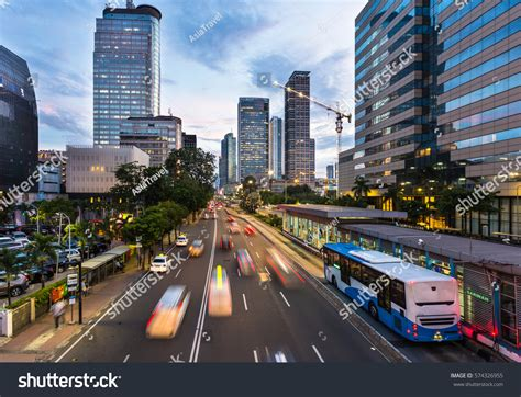 traffic rushes jakarta business district  stock photo