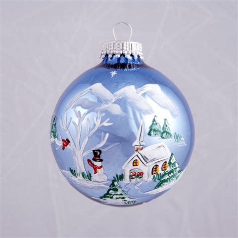 light blue village with cardinal ornament holiday decor