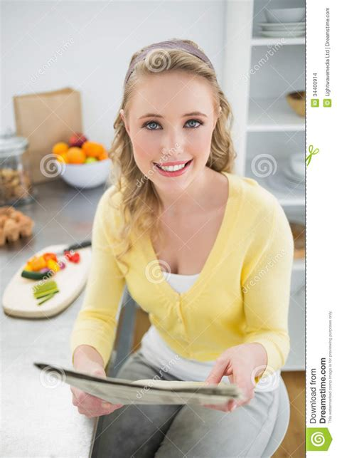 cute teenagers happy cute blonde holding newspaper stock photo image