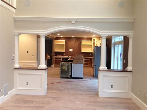 Livingroom World by Arched Opening With Walnut Half Walls And Columns
