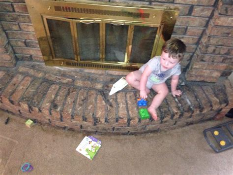child proof living room fireplace baby proofing help the bump