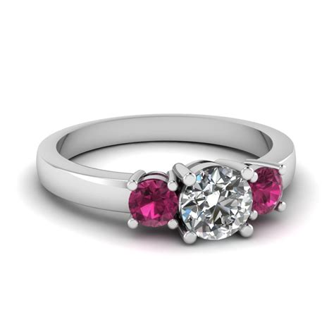 3 engagement ring with pink sapphire
