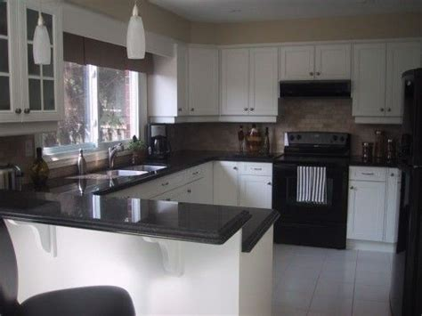 Kitchen With White Cabinets And Black Appliances Counter White Kitchen Cabinets With Black Appliances