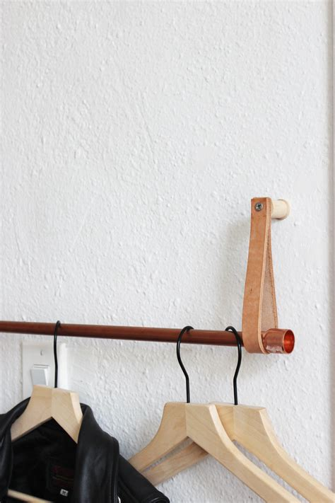 Diy Hanging Clothes Rack by Diy Copper And Leather Hanging Clothing Rack Hometohem
