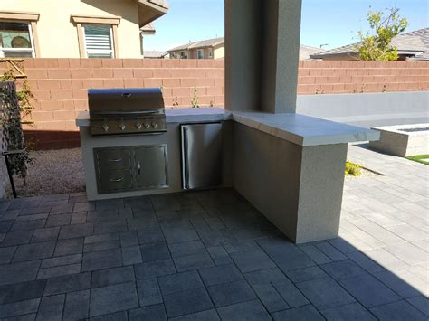 custom outdoor kitchen design by nevada outdoor living las vegas outdoor kitchens and barbecues magnetic attraction custom barbecue island bbq concepts