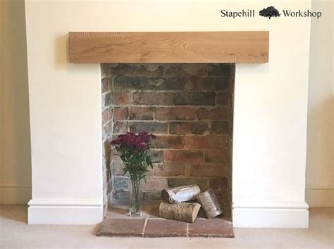 image result for empty exposed brick fireplace with beam