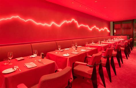 red restaurant rolf sachs mixes neon and red hues inside zurich