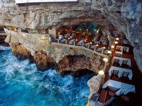 magnificent restaurant built into a cave in a cliff on the