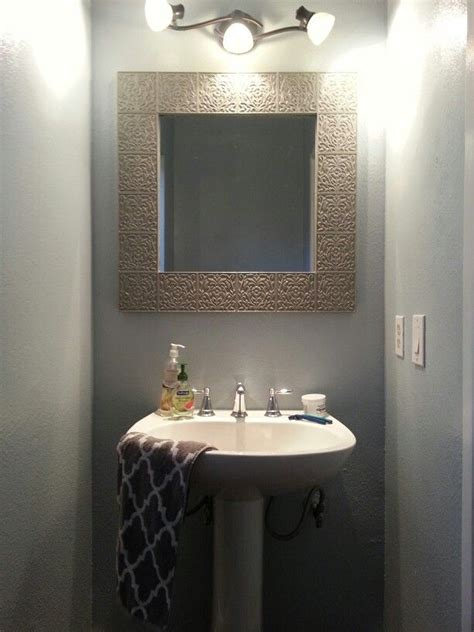 the mirror is painted in behr elephant skin and the walls in glidden antique silver my