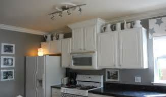 attractive What Color To Paint Walls With White Kitchen Cabinets #1: Innovative-Track-Lamps-on-White-Ceiling-in-Minimalist-Kitchen-with-White-Cabinets-beside-Grey-Walls-Kitchen.jpg