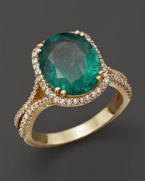 emerald and oval statement ring in 14k yellow gold