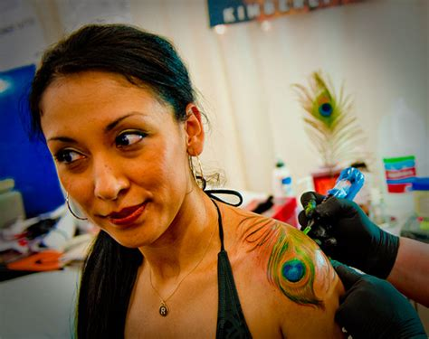 tattoo expo san diego cute peacock tattoo design on shoulder for women tattoomagz