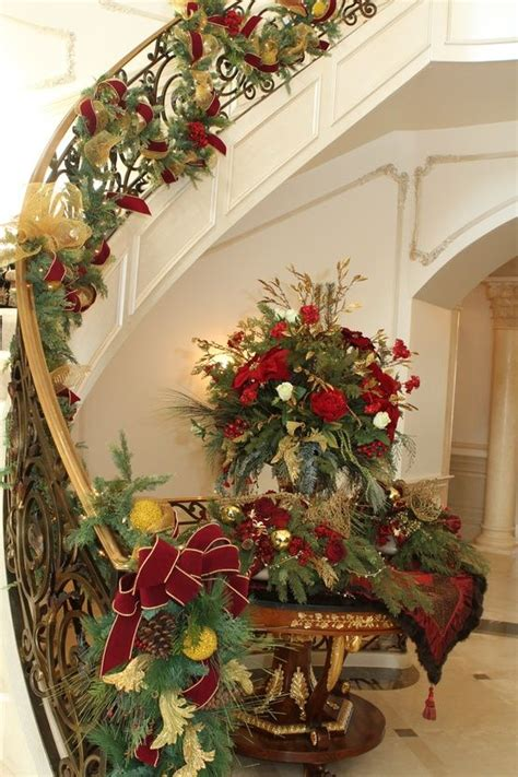 how to decorate banister with garland 168 best christmas staircase decor images on pinterest