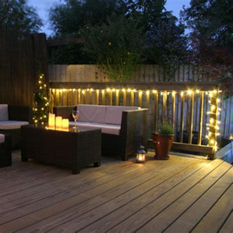 Stylish Wooden Deck With Wicker Furniture For Decorative Patio Lights Uk