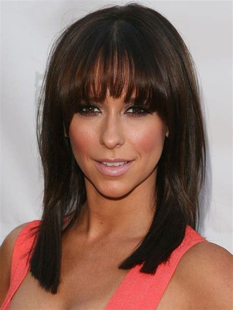 pictures of bangs shorter in the middle longer on sides jennifer love hewitt s asymmetrical bangs arc from long on