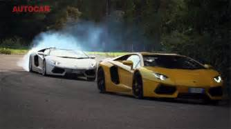 drag race lamborghini aventador coupe and roadster