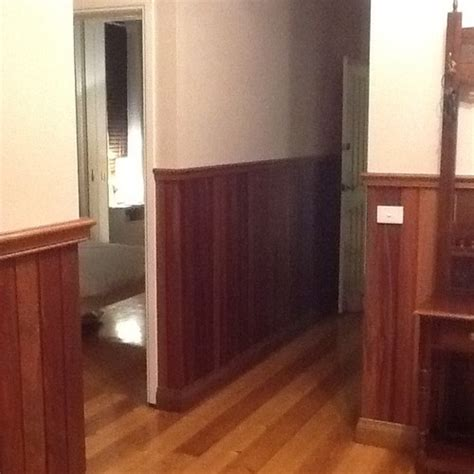 half wall wood paneling should i paint the panelling