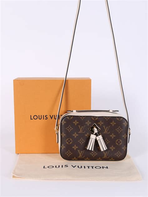 louis vuitton saintonge monogram canvas camera bag cream