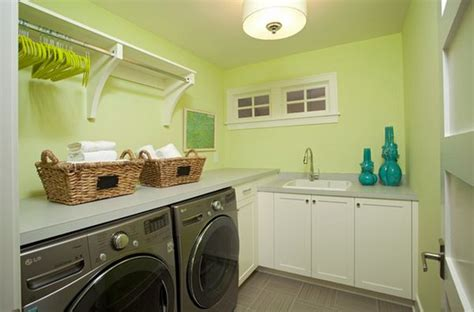 laundry room cabinets with hanging rod laundry room shelves keep everything organized and within