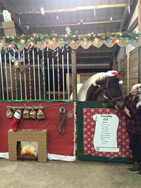 christmas decorating with horses stalls mounted deer heads and stalls on