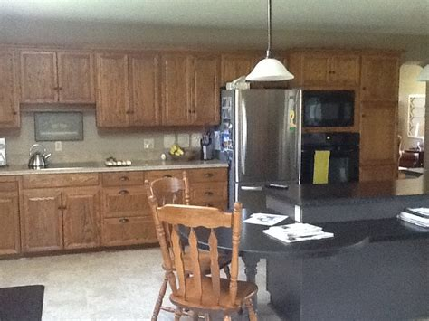 should i paint my kitchen cabinets designertrapped com hometalk colors to paint oak kitchen cabinets
