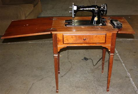 value of antique singer sewing machine in cabinet feelbern