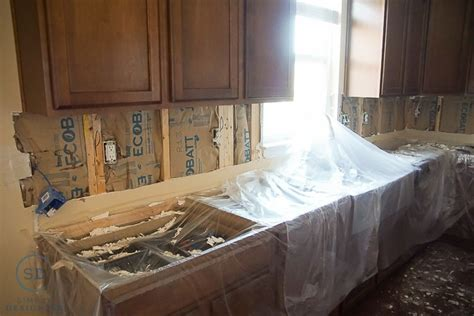 removing kitchen tile backsplash kitchen remodel reveal how to install a kitchen cabinet