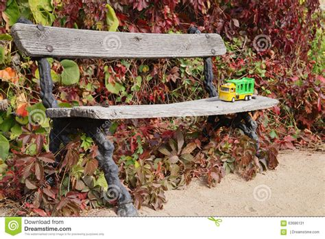 childrens park bench children s toy truck on a park bench stock photo image 63686131