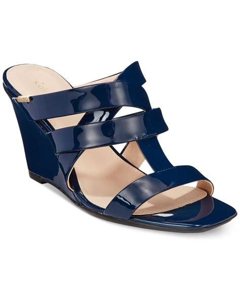 blue wedge sandals lyst calvin klein s nona wedge sandals in blue