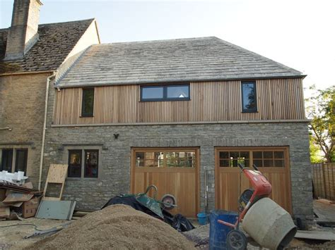 vertical cedar cladding on an over garage bedroom extension greystones contemporary extension