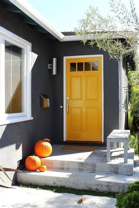 gray house yellow door 26 bold front door ideas in bright colors shelterness