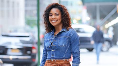 gabrielle union wears  skirt  pleats instylecom