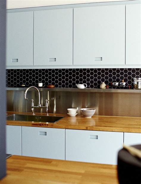 stainless steel backsplash shelf blue kitchen cabinets with routed out handles solid
