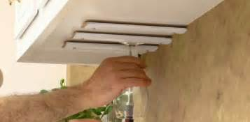Store and display wine glasses beneath your hanging kitchen cabinets