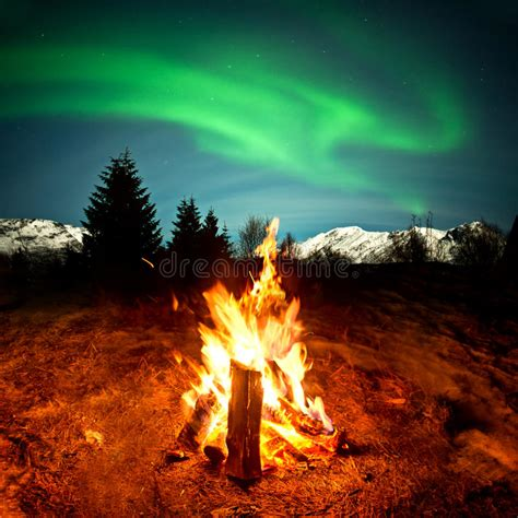 the hidden light of northern fires c fire watching northern lights stock image image