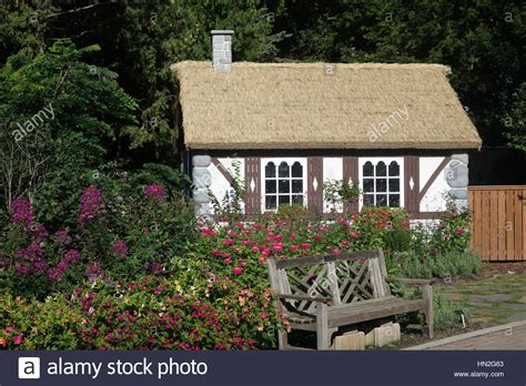 tudor style cottage tudor style cottage with thatch roof in garden