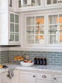 Blue Backsplash Kitchen by White Cabinets With Frosted Glass Blue Subway Tile