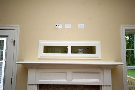 tv above fireplace where to put cable box where to put cable box with tv fireplace for