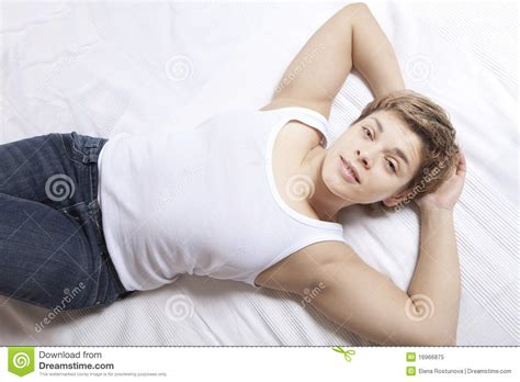 rested woman lying on bed royalty free stock photo image