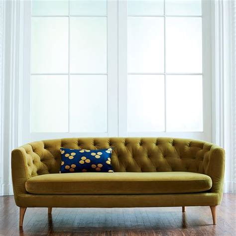 green avec sofa  brass legs