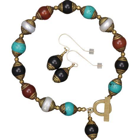 tibetan bead bracelet multi gemstone tibetan bead bracelet and earrings set from