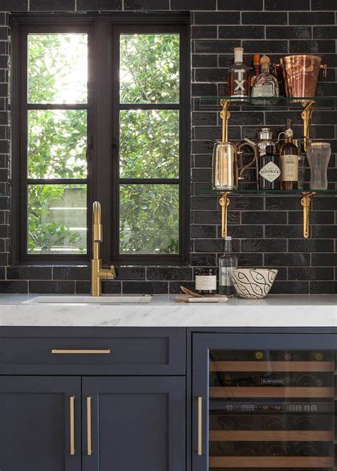 navy blue and gold kitchen glossy black wet bar backsplash with glass and brass