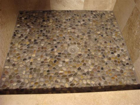 travertine river rock shower smooth stone shower floor add on ideas pinterest