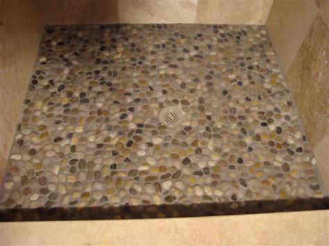 river rock tile bathroom floor smooth stone shower floor add on ideas pinterest