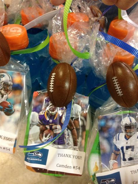 banquet party favors football favor sports drink with a box of pringles and a football card on
