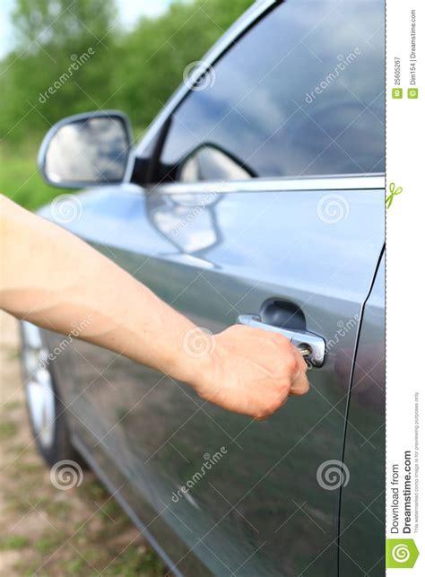 unlock door key download man driver unlocking or locking man unlock car door by key royalty free stock photography