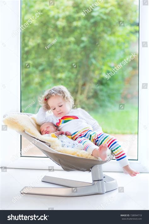 swing for baby boy newborn baby boy and his toddler sister relaxing in a